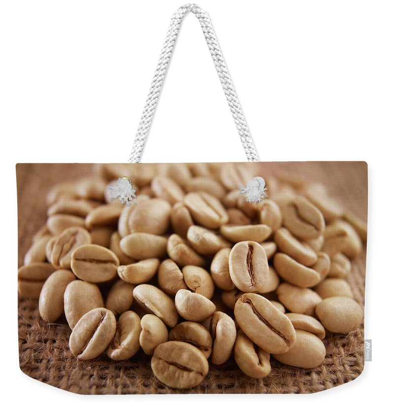 Heap Weekender Tote Bag featuring the photograph Close Up Of Raw Coffee Beans by Adam Gault