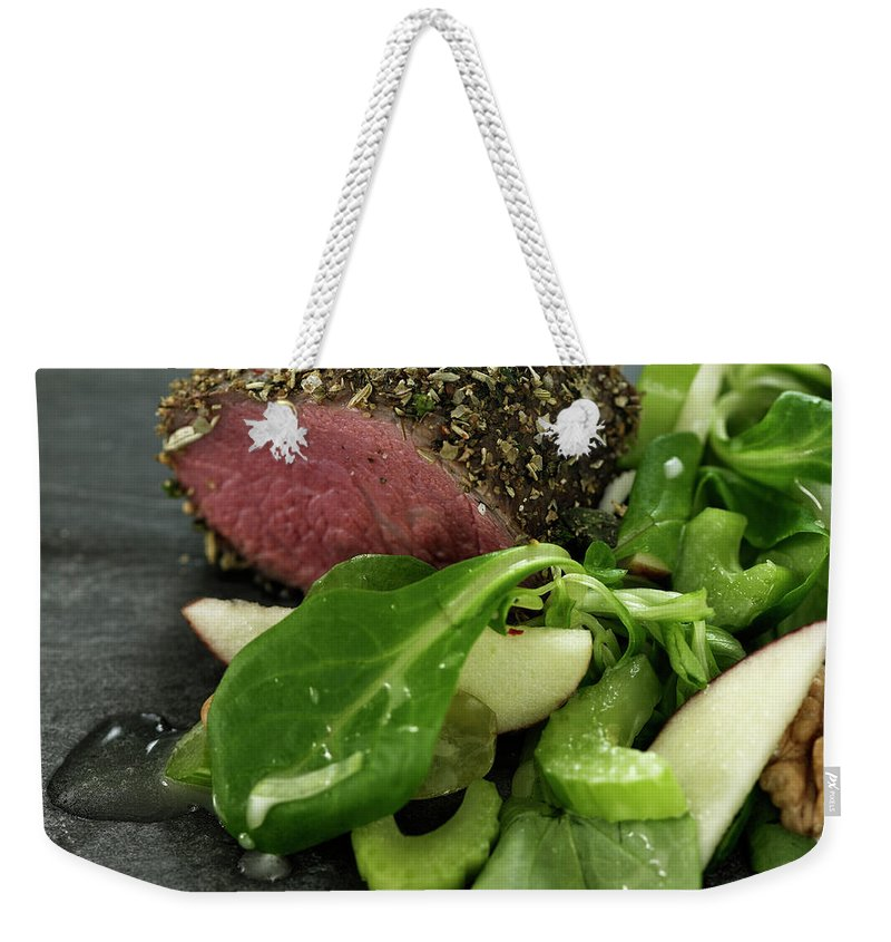 Tenderloin Weekender Tote Bag featuring the photograph Close Up Of Salad And Roasted Meat by Lisbeth Hjort