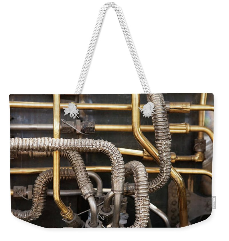 Abundance Weekender Tote Bag featuring the photograph Close-up Of Tangled Pipes by Ron Koeberer