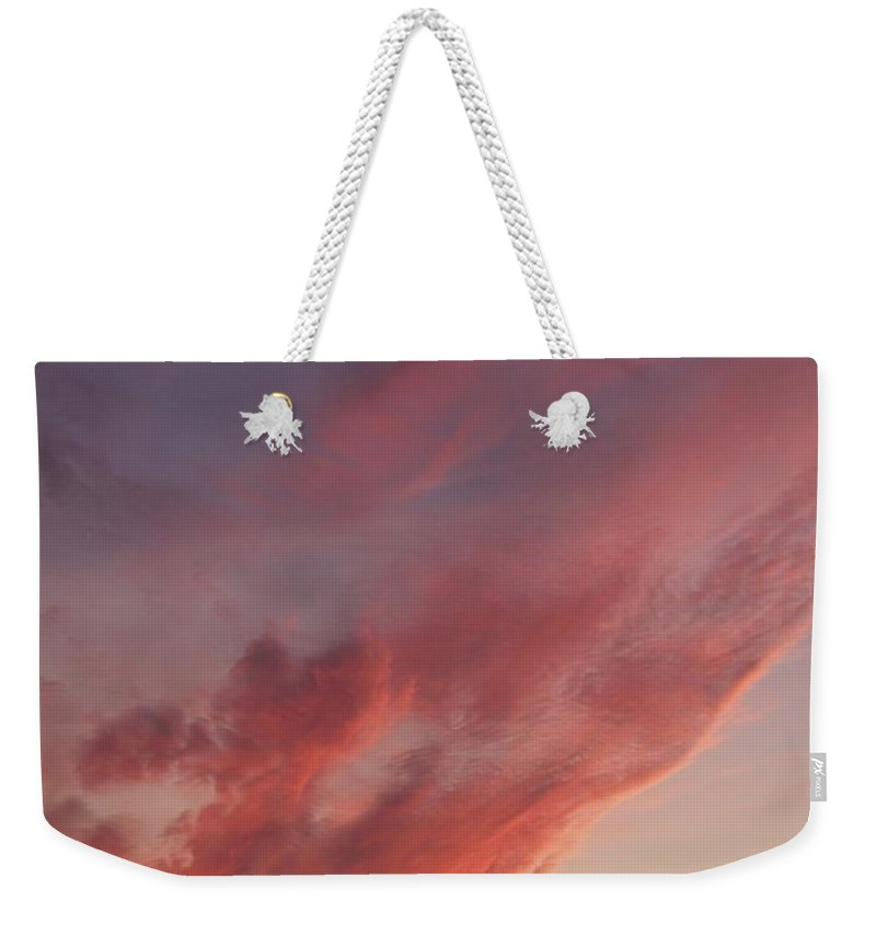 Landscapes Weekender Tote Bag featuring the photograph Cloud At Sunset by Eric Schiabor