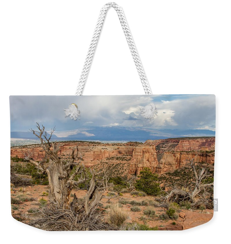 Colorado Weekender Tote Bag featuring the photograph Clouds Above by Jeff Stoddart