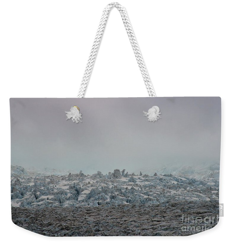 Ice Formations Weekender Tote Bag featuring the photograph Clouds And Ice by David Arment