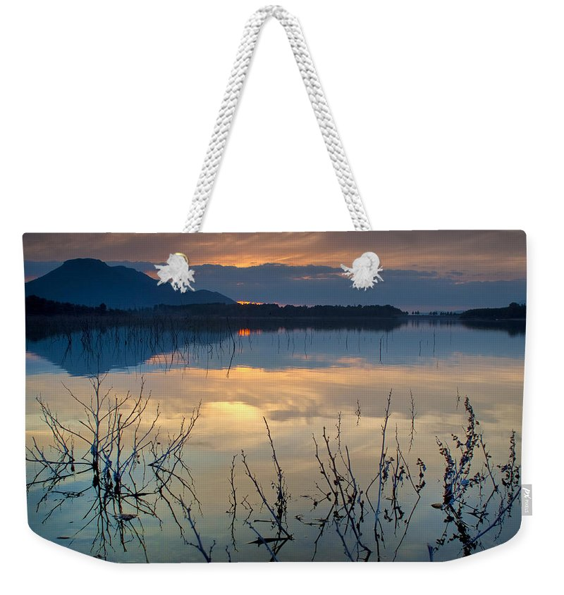 Sunset Weekender Tote Bag featuring the photograph Clouds On The Pink Water by Guido Montanes Castillo