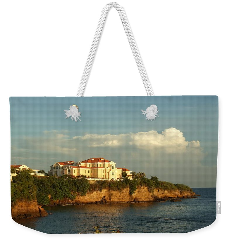 Weekender Tote Bag featuring the photograph Clouds Over Library by Katerina Naumenko