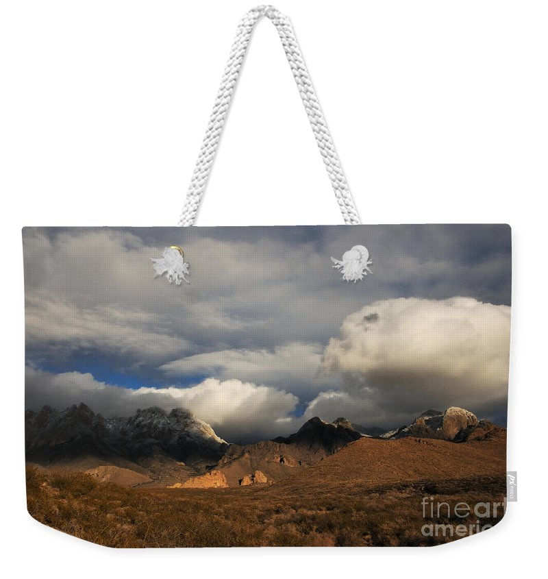 Las Cruces Weekender Tote Bag featuring the photograph Clouds Over The Organ Mountains by Vivian Christopher
