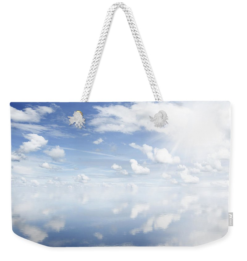 Sky Weekender Tote Bag featuring the photograph Clouds Reflected by Les Cunliffe