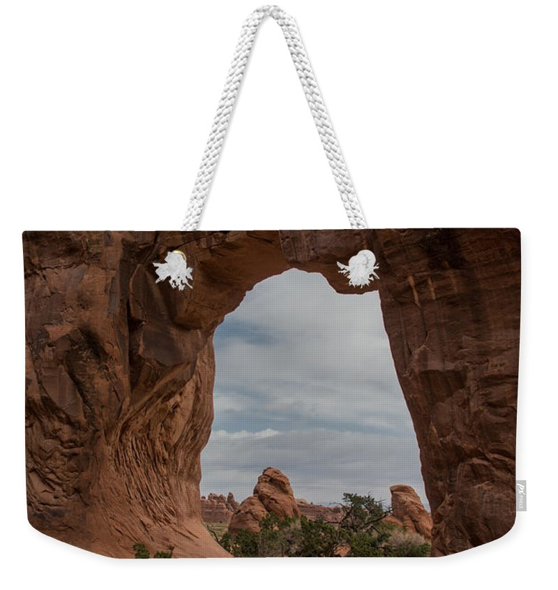 Charlie Choc Weekender Tote Bag featuring the photograph Cloudy Day At Pine Tree Arch by Charlie Choc