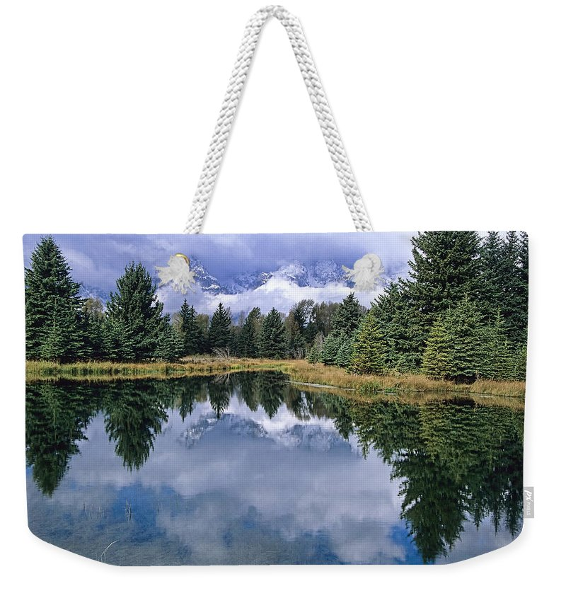 Grand Teton Weekender Tote Bag featuring the photograph Cloudy Reflection by Sharon M Connolly
