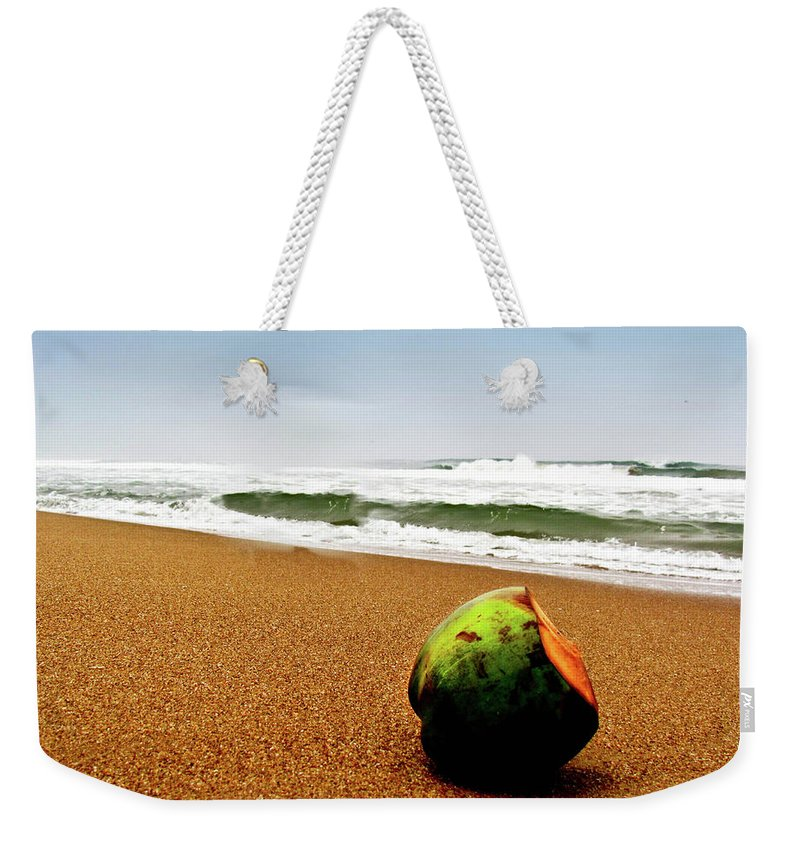 Tranquility Weekender Tote Bag featuring the photograph Coconut On Sandy Beach With Waves And by Amlan Mathur