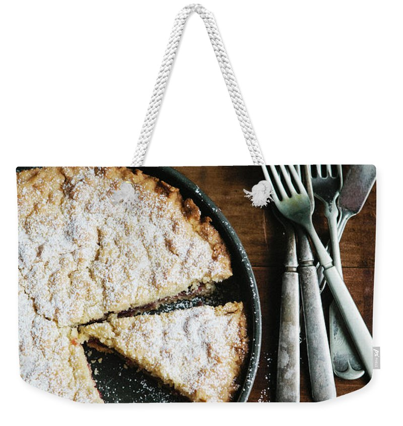 Kitchen Knife Weekender Tote Bag featuring the photograph Coffee Cake In Rustic Pan With Forks by Alina Spradley