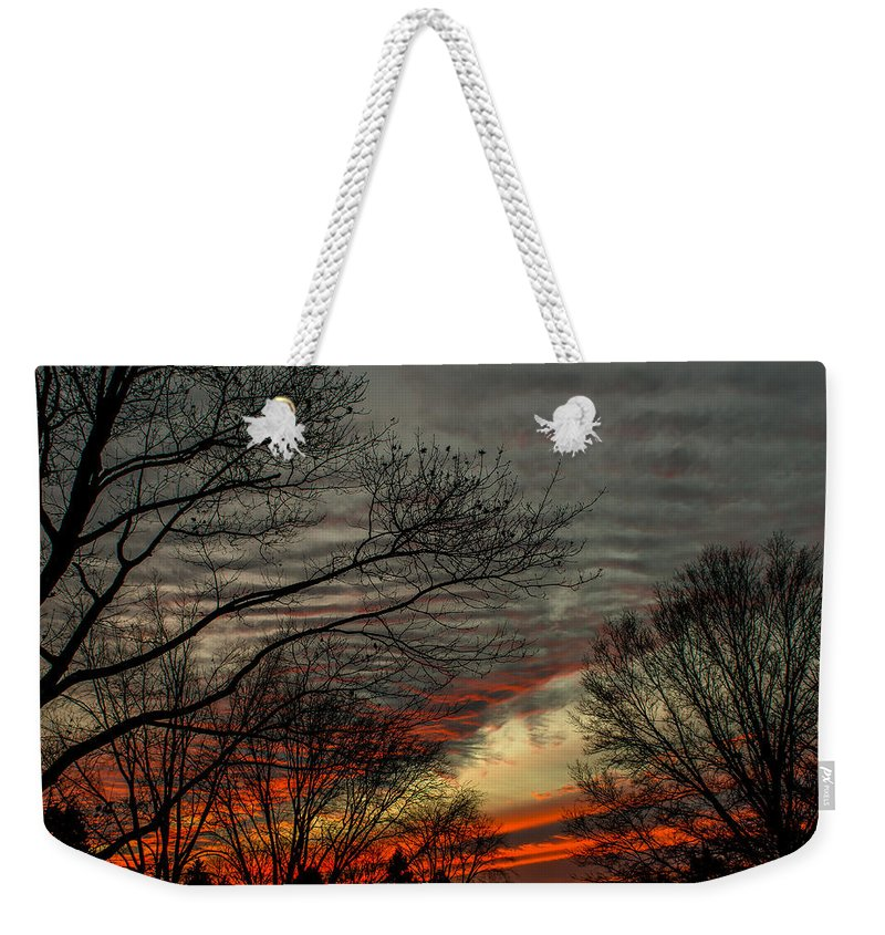 Sunset Weekender Tote Bag featuring the photograph Cold Front Sunset by Scott Hafer