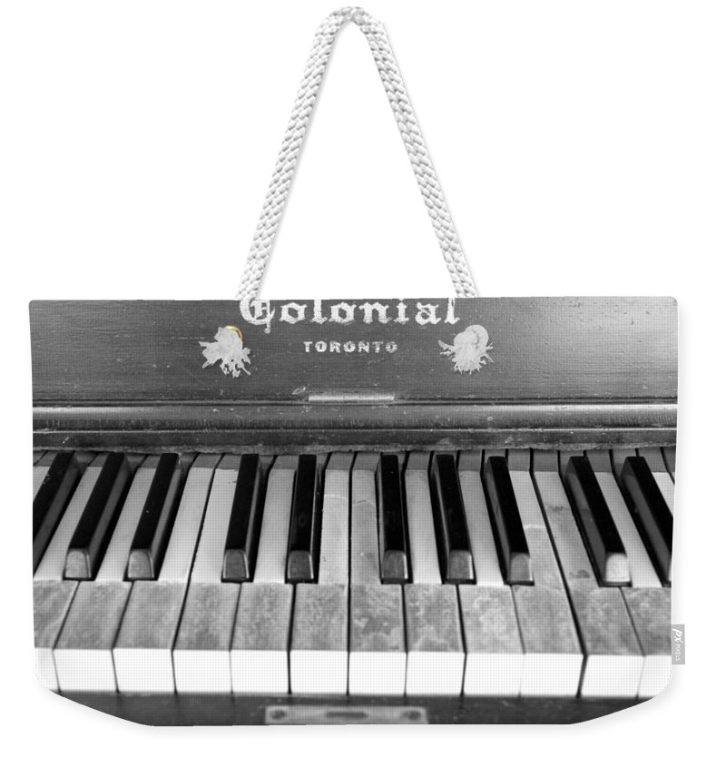 Old Weekender Tote Bag featuring the photograph Colonial Piano by Valentino Visentini