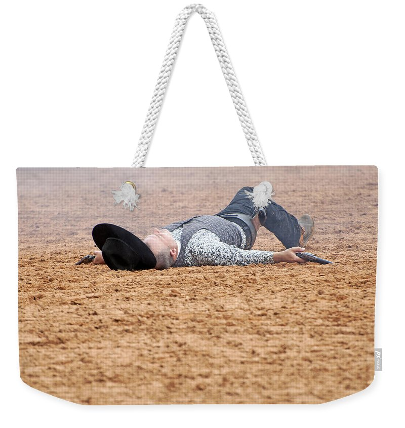 Rodeo Weekender Tote Bag featuring the photograph Color Rodeo Gunslinger Victim by Sally Rockefeller