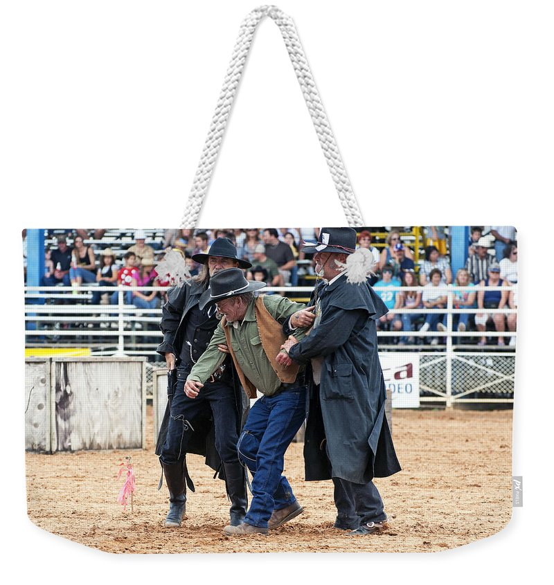 Rodeo Weekender Tote Bag featuring the photograph Color Rodeo Shootout Deputies Arrest Outlaw by Sally Rockefeller