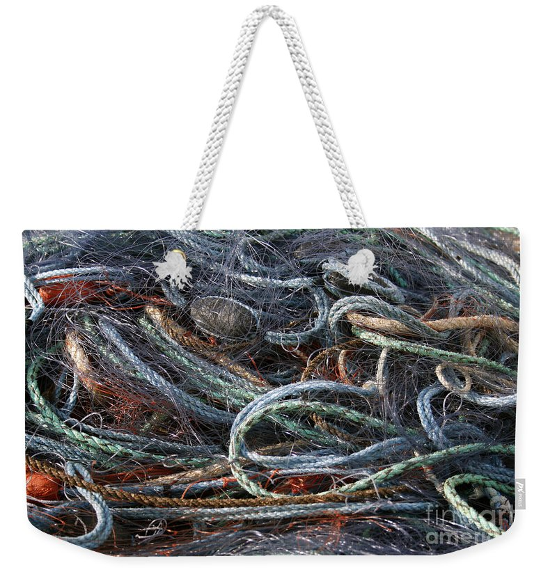 Background Weekender Tote Bag featuring the photograph Colorful Fishing Nets by Patricia Hofmeester