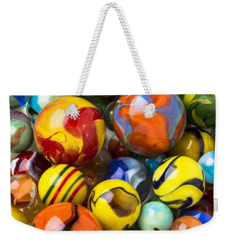Pile Weekender Tote Bag featuring the photograph Colorful Glass Marbles by Garry Gay