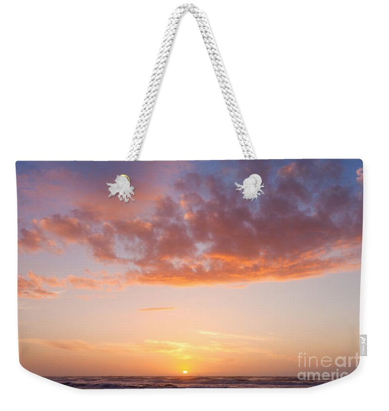 Atmosphere Weekender Tote Bag featuring the photograph Colorful Sunset Cloudscape Over Beach And Ocean by Stephan Pietzko