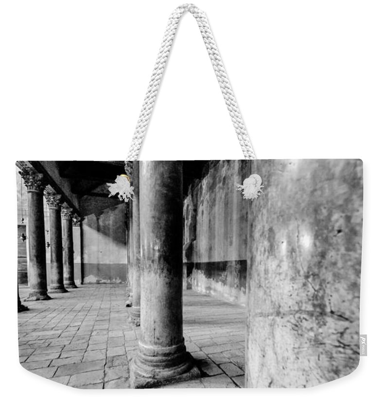 Bethlehem Weekender Tote Bag featuring the photograph Columns At The Church Of Nativity Black And White Vertical by David Morefield