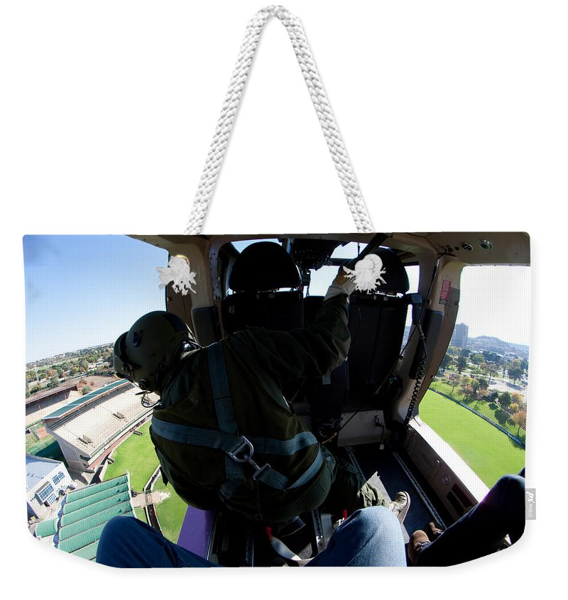 Agustawestland Aw109 Weekender Tote Bag featuring the photograph Coming In To Land by Paul Job