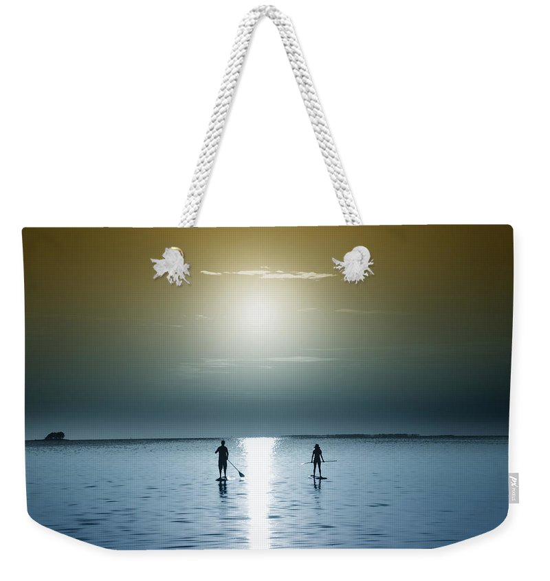 Coming Out Of The Sun Weekender Tote Bag featuring the photograph Coming Out Of The Sun by Bill Cannon
