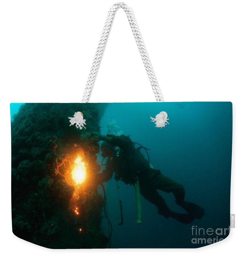 Commercial Diver Weekender Tote Bag featuring the photograph Commercial Diver At Work by Hagai Nativ