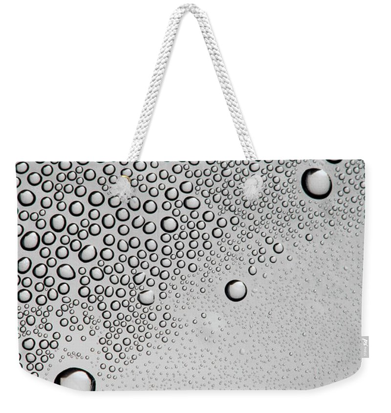 Part Of A Series Weekender Tote Bag featuring the photograph Condensation On A Shiny Surface by Larry Washburn