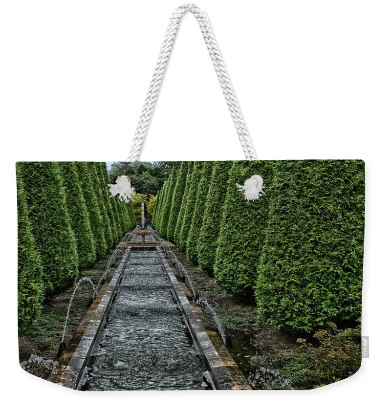 Conifer Water Feature Weekender Tote Bag featuring the photograph Conifer Lined Water Feature by Brothers Beerens