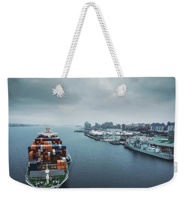Freight Transportation Weekender Tote Bag featuring the photograph Container Ship In Halifax Harbour by Shaunl