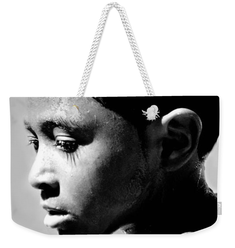 Candid Weekender Tote Bag featuring the photograph Contemplation by Diana Angstadt