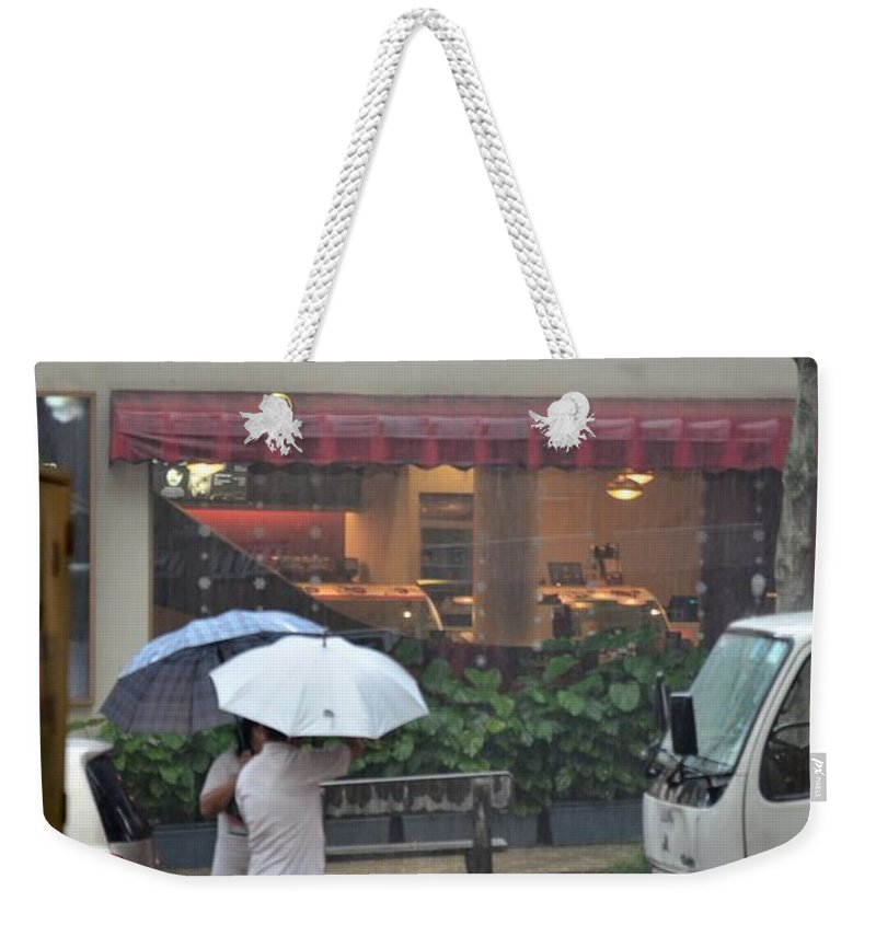 Singapore Weekender Tote Bag featuring the photograph Conversation In The Rain by Imran Ahmed
