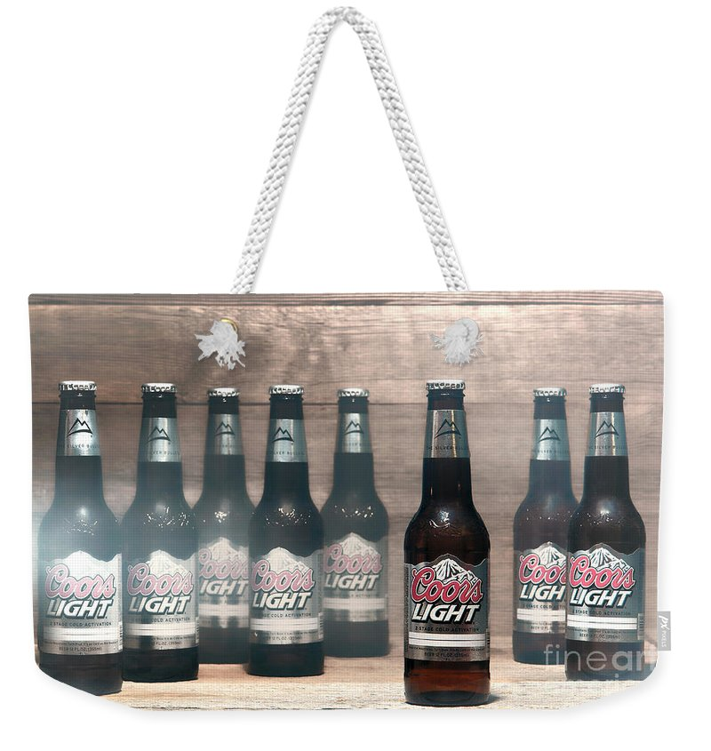 Coors Weekender Tote Bag featuring the photograph Coors Light by Olivier Le Queinec