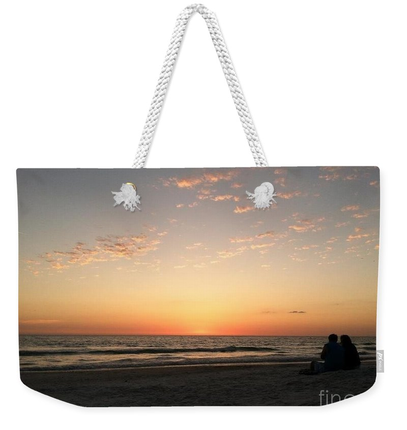 Couple Weekender Tote Bag featuring the photograph Couple At Sunset by Melissa Darnell Glowacki