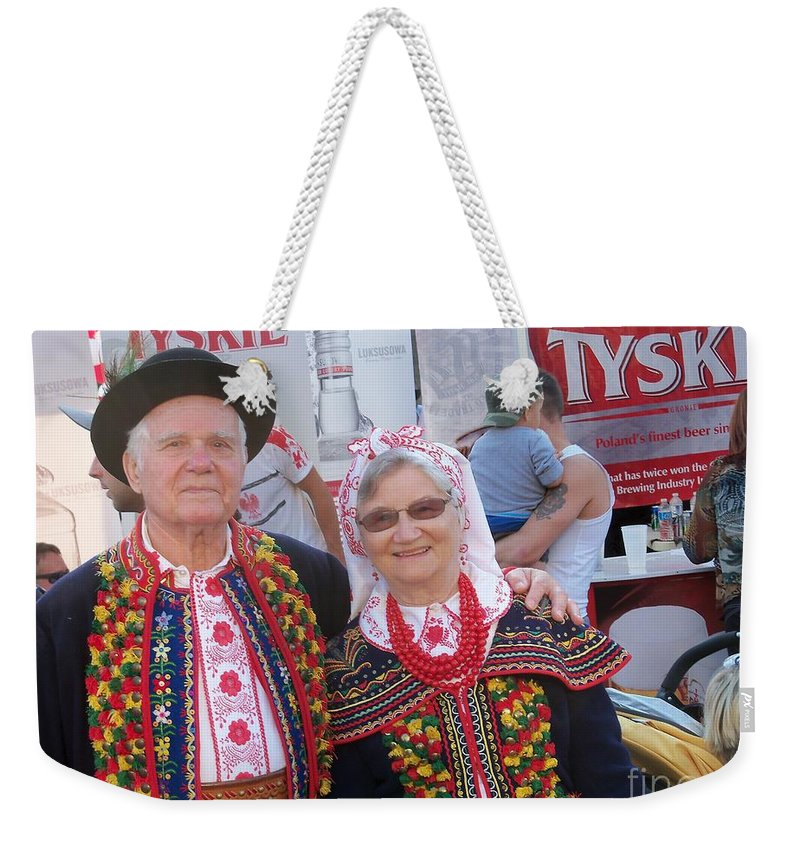 Street Festival Weekender Tote Bag featuring the photograph Couples In Polish National Costumes by Lingfai Leung