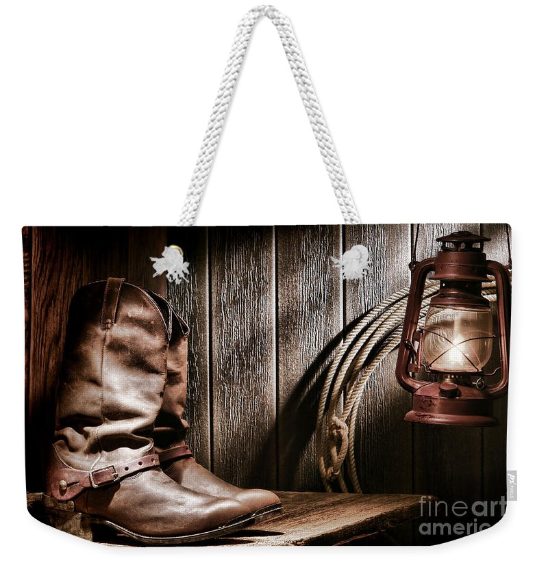 Boots Weekender Tote Bag featuring the photograph Cowboy Boots In Old Barn by Olivier Le Queinec