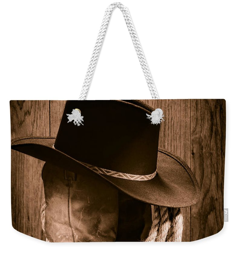 Boots Weekender Tote Bag featuring the photograph Cowboy Hat And Boots by Olivier  Le Queinec 9d76900fa0b8