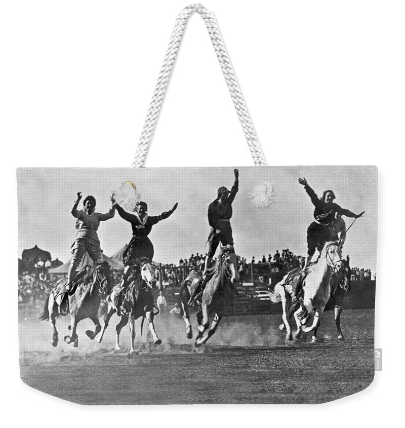 1920's Weekender Tote Bag featuring the photograph Cowgirls At The Rodeo by Underwood Archives