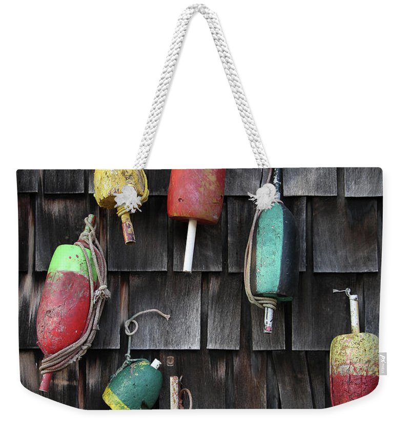 Cedar Tree Weekender Tote Bag featuring the photograph Crab Pot Floats by Photo By Wayne Bierbaum; Annapolis, Maryland