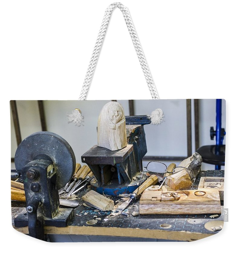 Craftsman Weekender Tote Bag featuring the photograph Craftsman Work Table by Paulo Goncalves