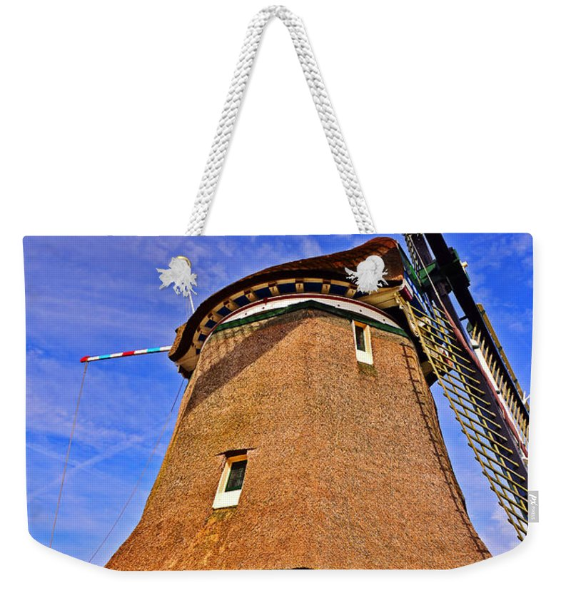 Travel Weekender Tote Bag featuring the photograph Creating Land by Elvis Vaughn