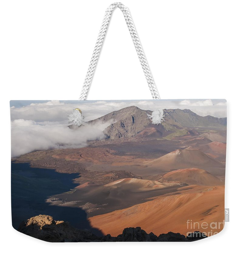Volcanic Cone Crater Cone Craters Volcano Volcanos Haleakala National Park Volcano Area Maui Hawaii Landscape Landscapes Parks Mountain Mountains Shadow Shadows Landmark Landmarks Weekender Tote Bag featuring the photograph Creeping Shadows by Bob Phillips