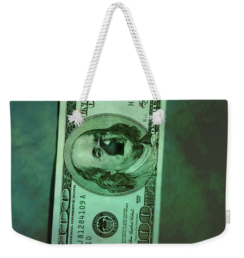 Money; Bill; Us; United States; United States Of America; America; 100; Dollars; Currency; Wealth; Rich; Bullet; Hole; Broke; Broken; Bankrupt; Bankruptcy; Crime; Thriller; Mystery; Mysterious; Ominous; Foreboding; Green; Greenback; Dark; Darkness; Hundred; Damaged; Destroyed; Rip; Ripped Weekender Tote Bag featuring the photograph Crime by Margie Hurwich