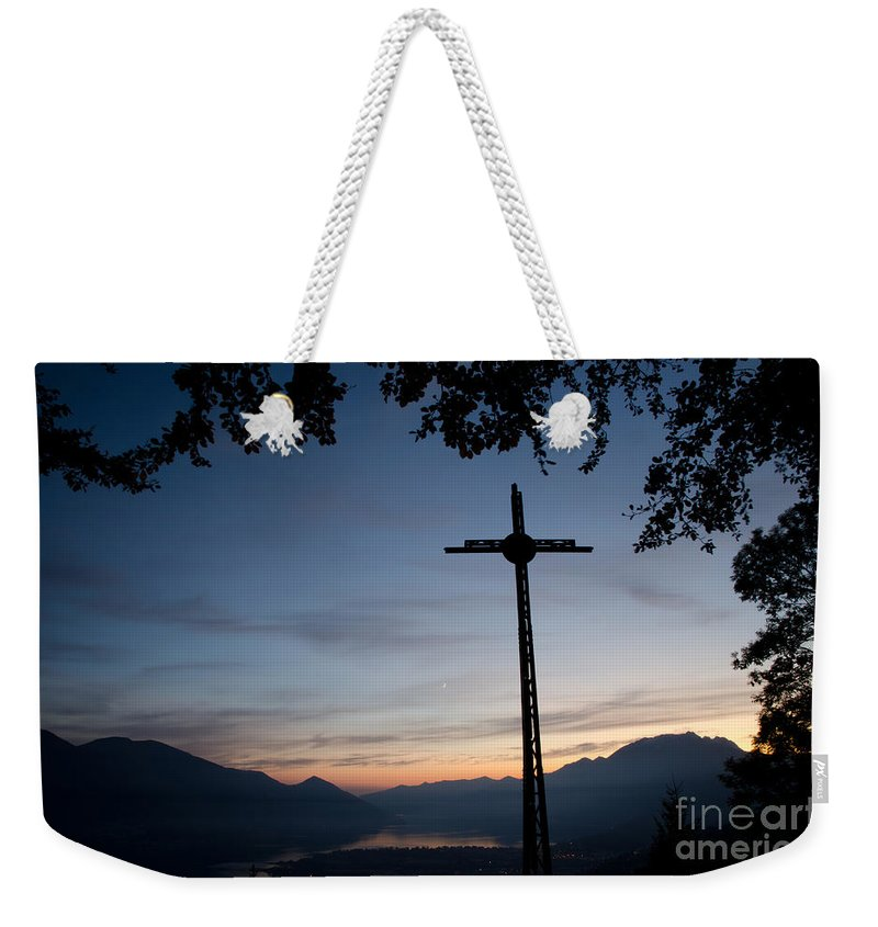 Cross Weekender Tote Bag featuring the photograph Cross On The Mountain by Mats Silvan