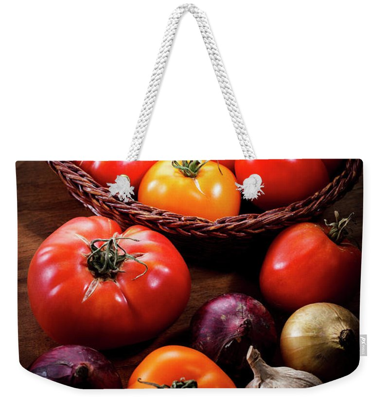 Yield Sign Weekender Tote Bag featuring the photograph Crop Tomatoes by Letty17