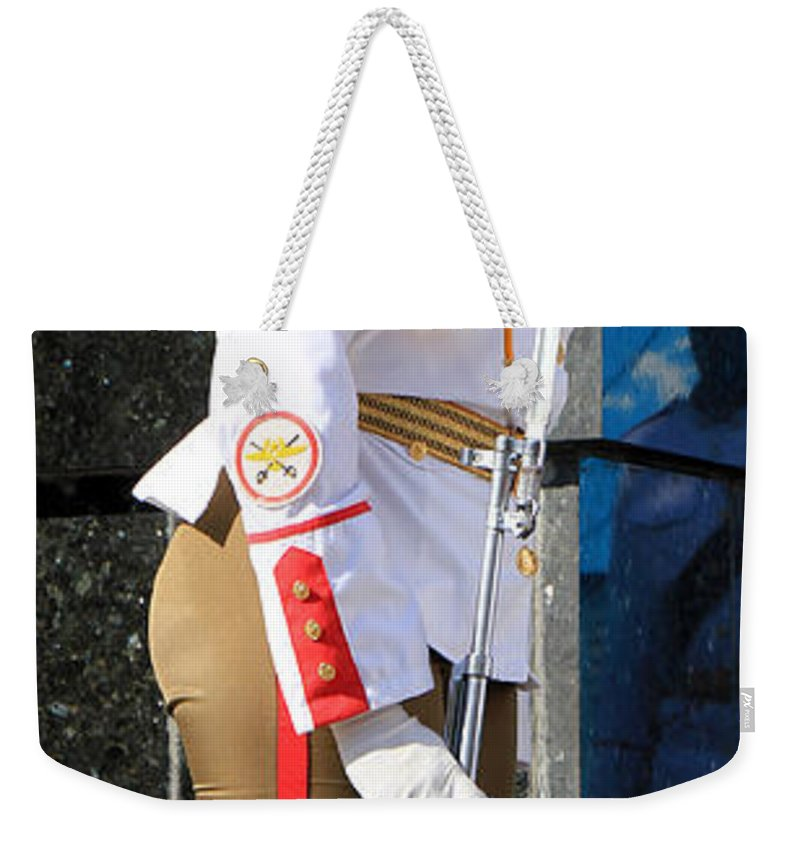 Cuba Weekender Tote Bag featuring the photograph Cuban Soldier 1 by Andrew Fare