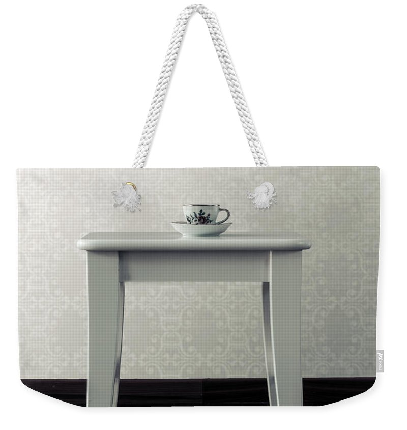 Cup Weekender Tote Bag featuring the photograph Cup On Stool by Joana Kruse