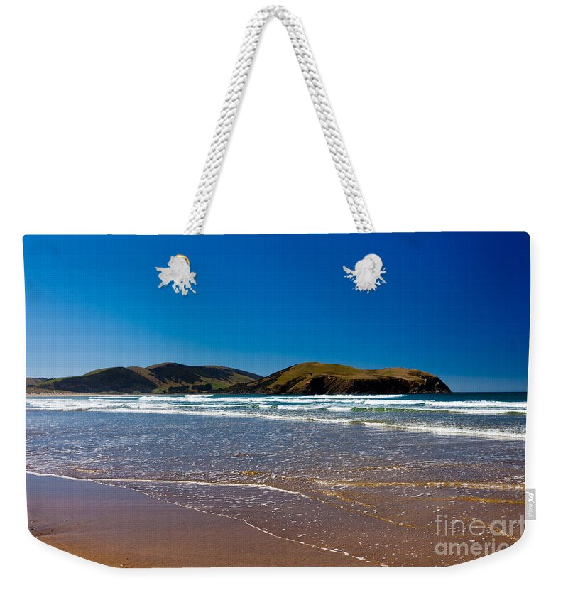 South Island Weekender Tote Bag featuring the photograph Curio Bay On South Coast Of New Zealand South Island by Stephan Pietzko