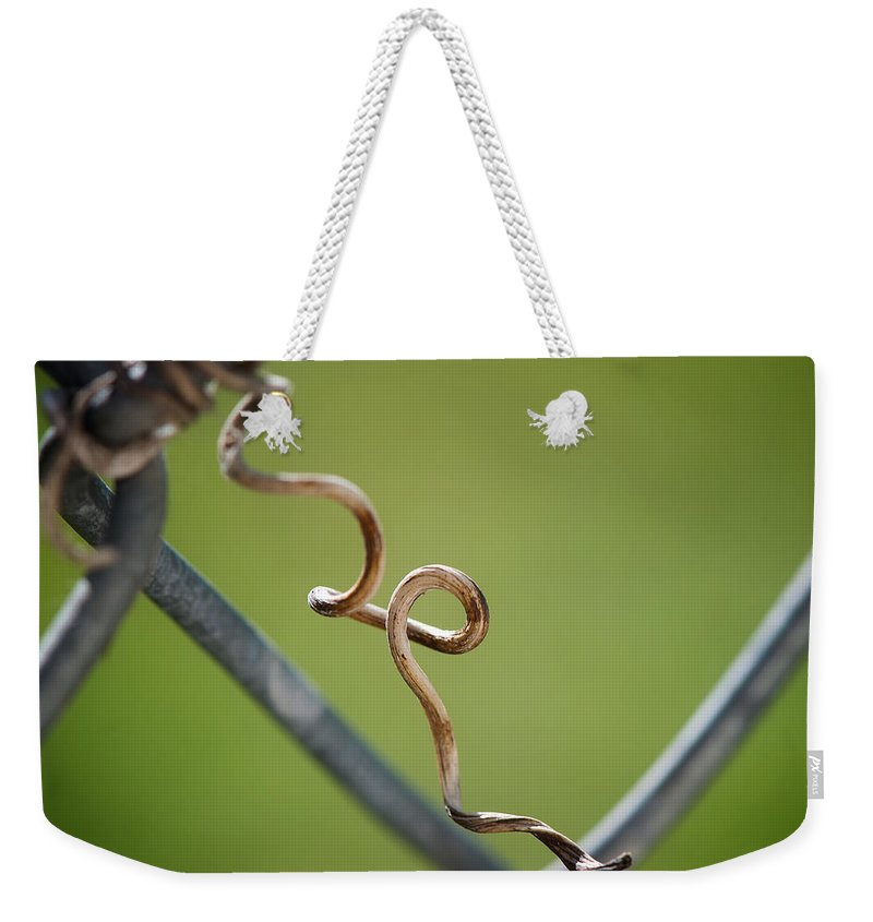 Fence Weekender Tote Bag featuring the photograph Curled by Lisa Knechtel