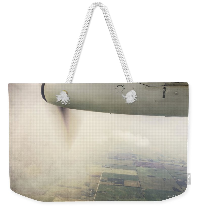 Prop Weekender Tote Bag featuring the photograph Cutting Through The Fog With Turboprop Over Alberta by Angela Stanton