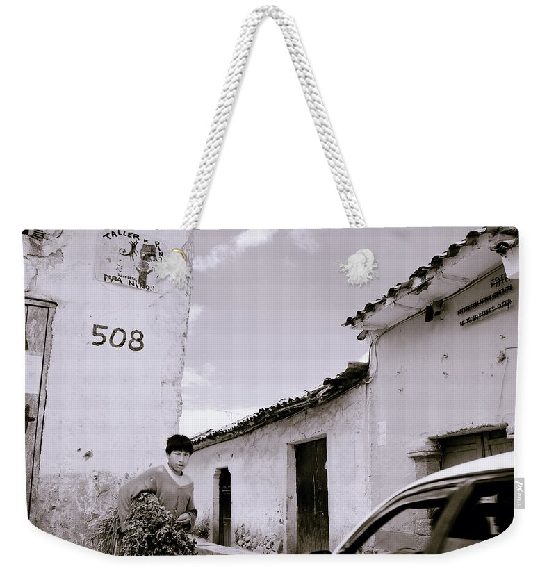 Cuzco Weekender Tote Bag featuring the photograph The Streets Of Cuzco by Shaun Higson
