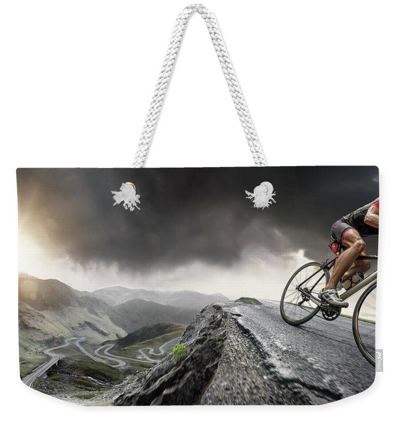 Sports Helmet Weekender Tote Bag featuring the photograph Cyclist Climbs To The Top by Peepo